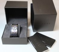 "Gucci lady's stainless steel ""Twirl"" bracelet watch with bronzed dial and diamond set bezel, model"