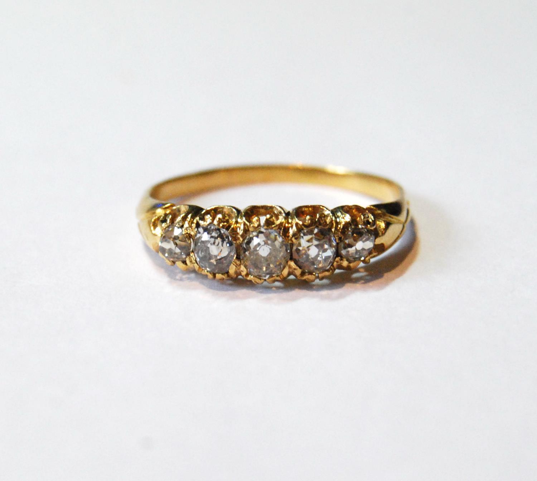 Victorian diamond five-stone half hoop ring, old-cut brilliants, in gold, size Q.