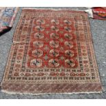 Tekke rug, the three rows of six guls over faded red ground and multiple border, 151cm x 120cm.