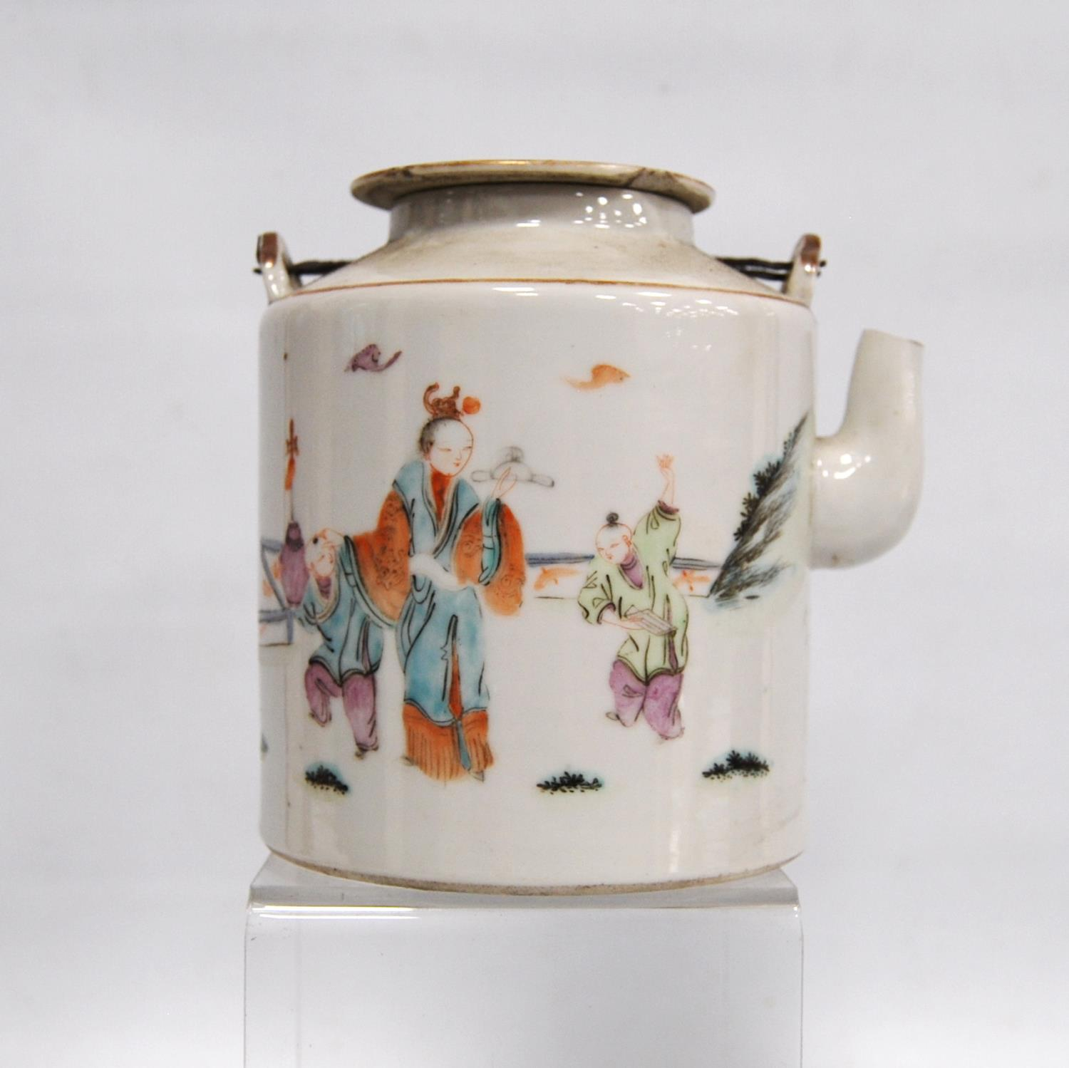 Canton famille rose teapot decorated with children and their teacher, marks to the base, 14cm high.