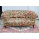 Victorian chesterfield sofa with buttoned back and seat, on tapering ring turned legs and ceramic