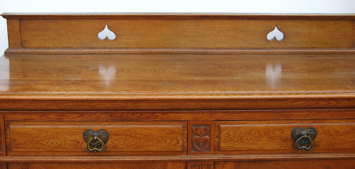 Aesthetic oak sideboard, the back panel with pierced inverted hearts, moulded rectangular top over - Image 3 of 7