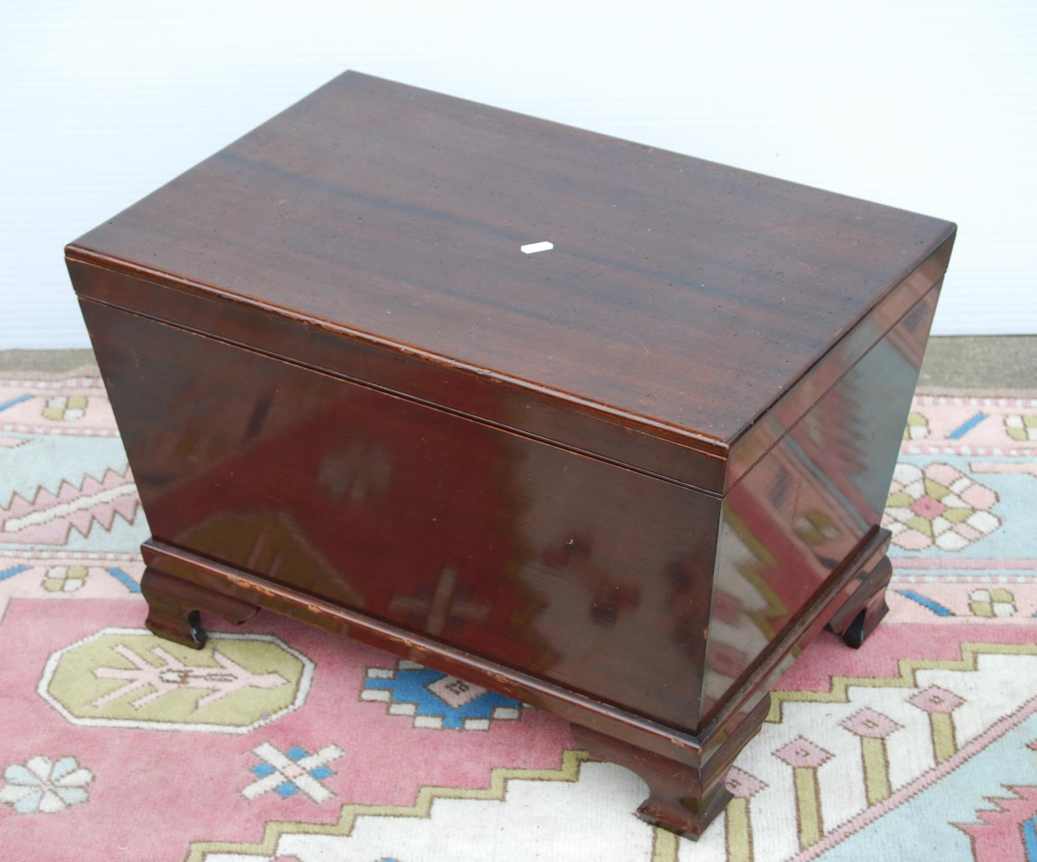 Mahogany cellarette by Irving & Sons, Annan of rectangular casket form enclosing liner, on ogee