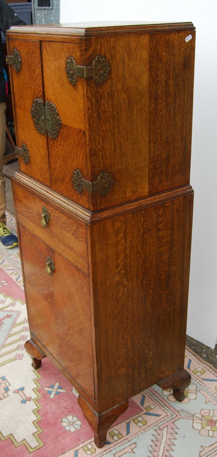 Edwardian oak cabinet on stand, the rectangular top above a cupboard with elaborate hinges and - Image 4 of 4
