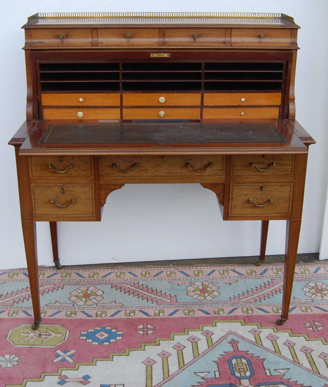 Edwardian mahogany cylinder desk made by John Taylor & Son, Edinburgh, May 1915, the pierced
