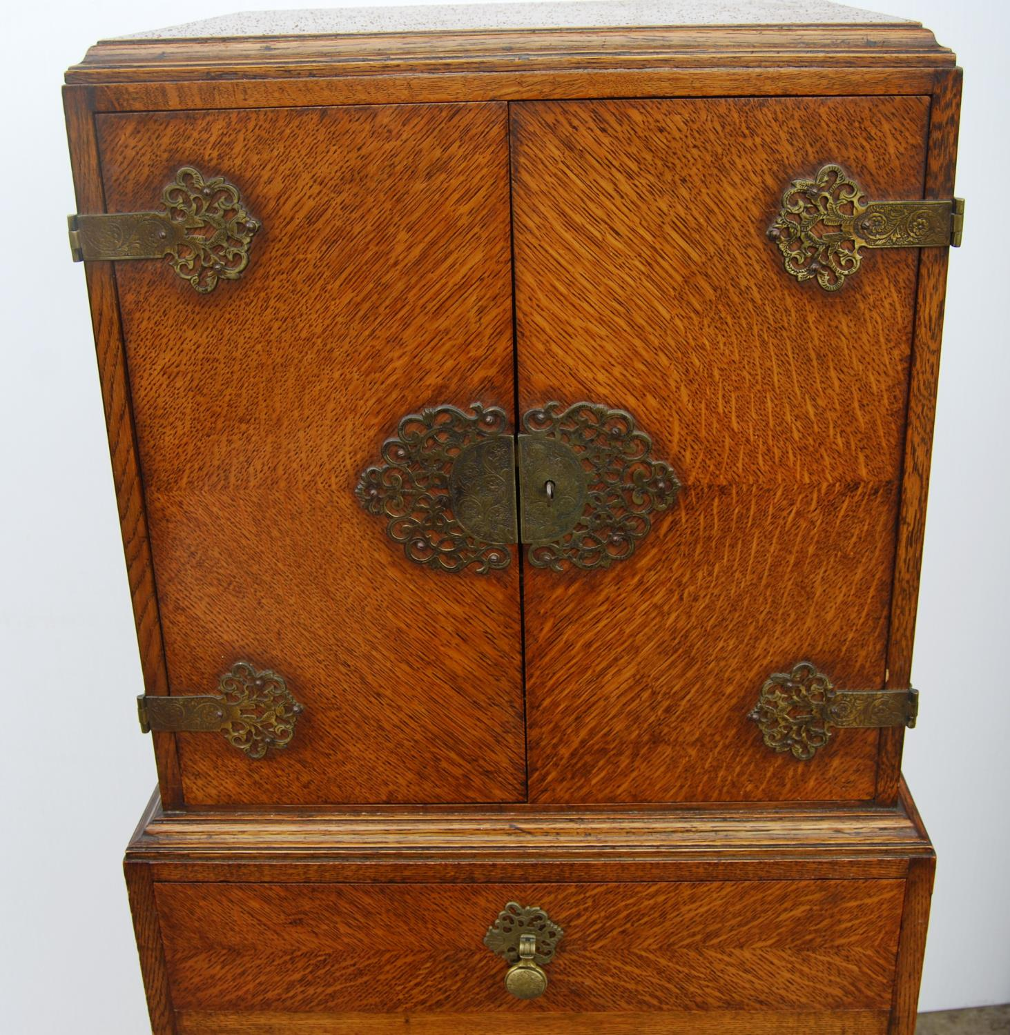 Edwardian oak cabinet on stand, the rectangular top above a cupboard with elaborate hinges and - Image 3 of 4