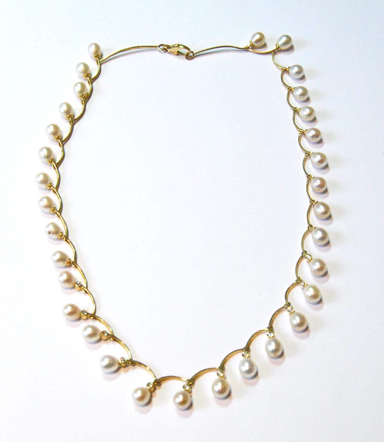 Gold and cultured pearl necklace with twelve small diamonds, collet-set, '750', 25g gross.