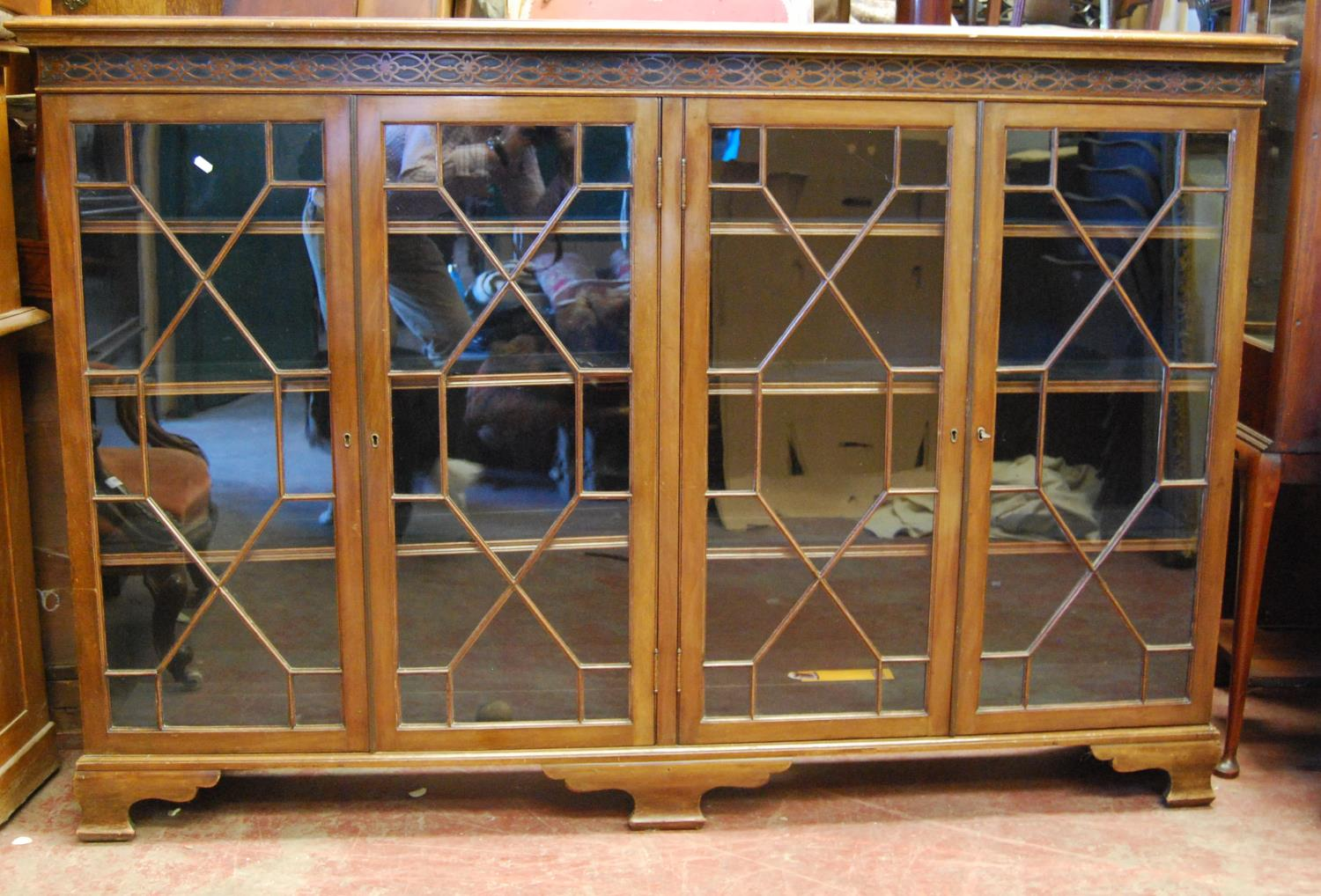 George III style mahogany bookcase, the moulded rectangular top over closed fretwork frieze, four