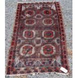 Afghan rug with two rows of four guls, spandrels over brown ground, 146cm x 82cm.