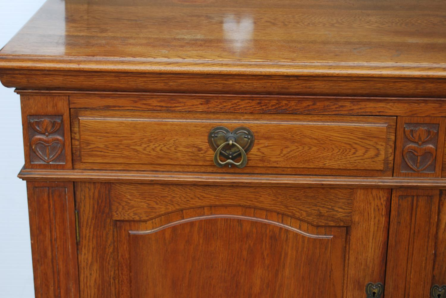 Aesthetic oak sideboard, the back panel with pierced inverted hearts, moulded rectangular top over - Image 2 of 7