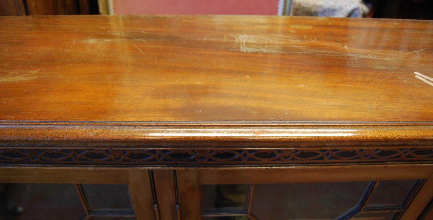 George III style mahogany bookcase, the moulded rectangular top over closed fretwork frieze, four - Image 3 of 3