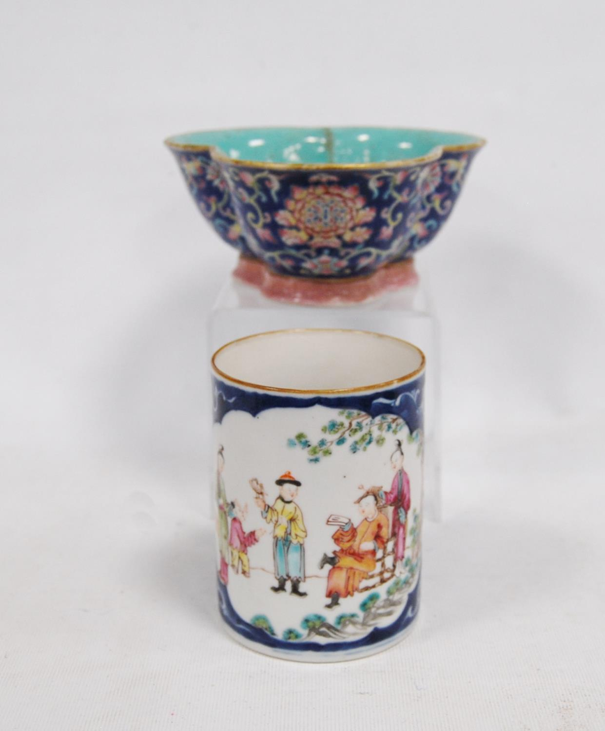 Trefoil bowl decorated with chrysanthemums over blue ground, pink scrolling foot, turquoise inner,