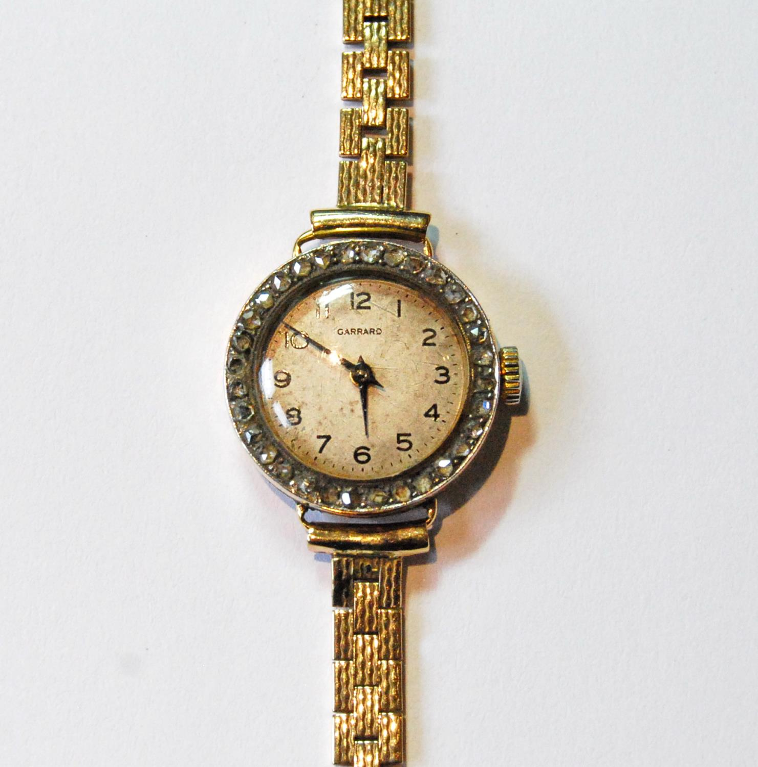 Garrard lady's 18ct gold watch with diamond-set bezel, 1919, movement replaced, on 9ct gold