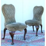 Pair of George II style side chairs, each with upholstered shaped back, sprung stuff-over seat, on