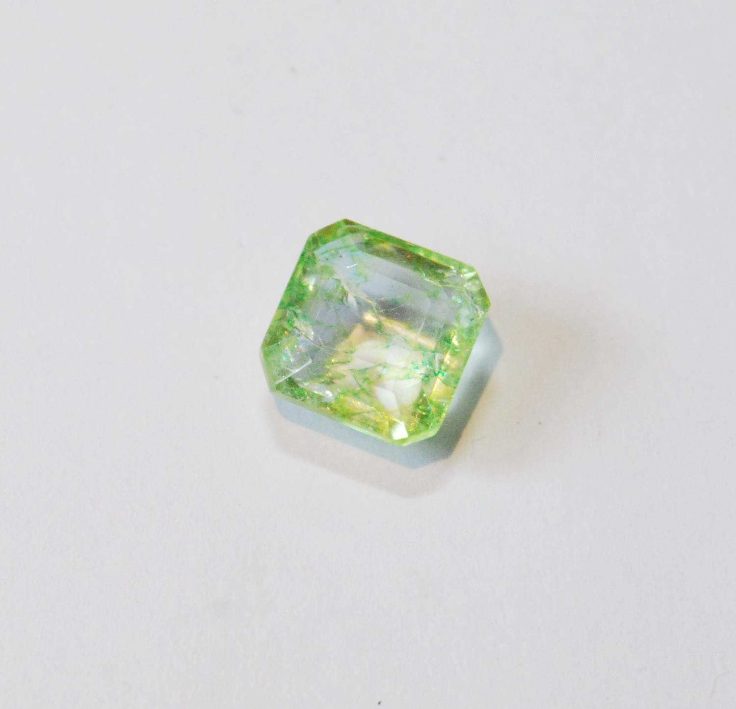 Unmounted square emerald with NGL report, given as 8.65ct, 12.24mm x 7.26mm, treated, of almost lime