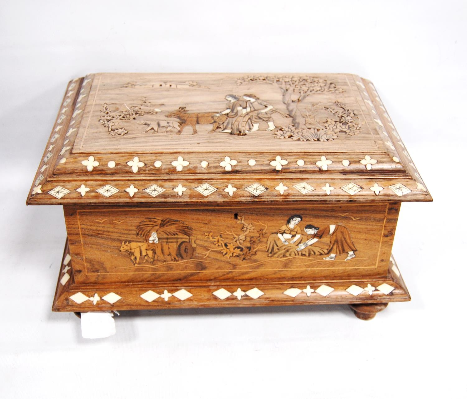 Inlaid rosewood casket-shaped box decorated with a rural scene, with hinged rectangular lid and