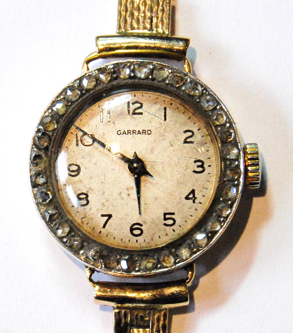 Garrard lady's 18ct gold watch with diamond-set bezel, 1919, movement replaced, on 9ct gold - Image 2 of 4