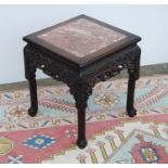 Oriental hardwood and marble jardinière stand, the moulded square top with marble inset panel over
