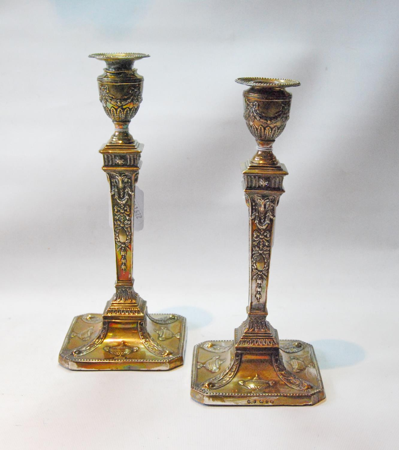 Pair of silver table candlesticks of Adams style with tapering embossed stems of square section,