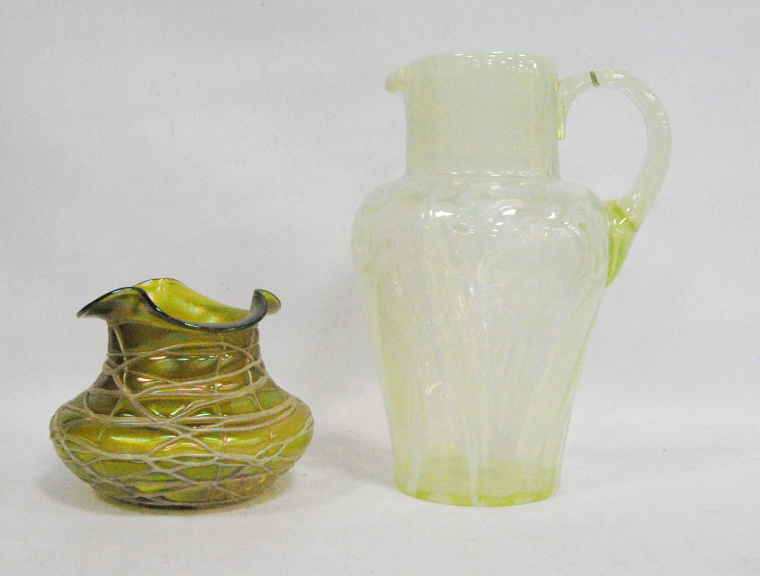 Loetz-style glass vase, 11cm high, also a vaseline-style jug with floral decoration, 23cm high. (2)