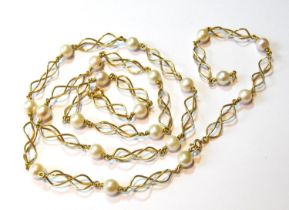 Gold necklace of entwined curb pattern with twenty cultured pearls, '750', gross 49g.