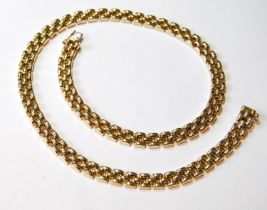 9ct gold necklace of rounded brick pattern, 32g.