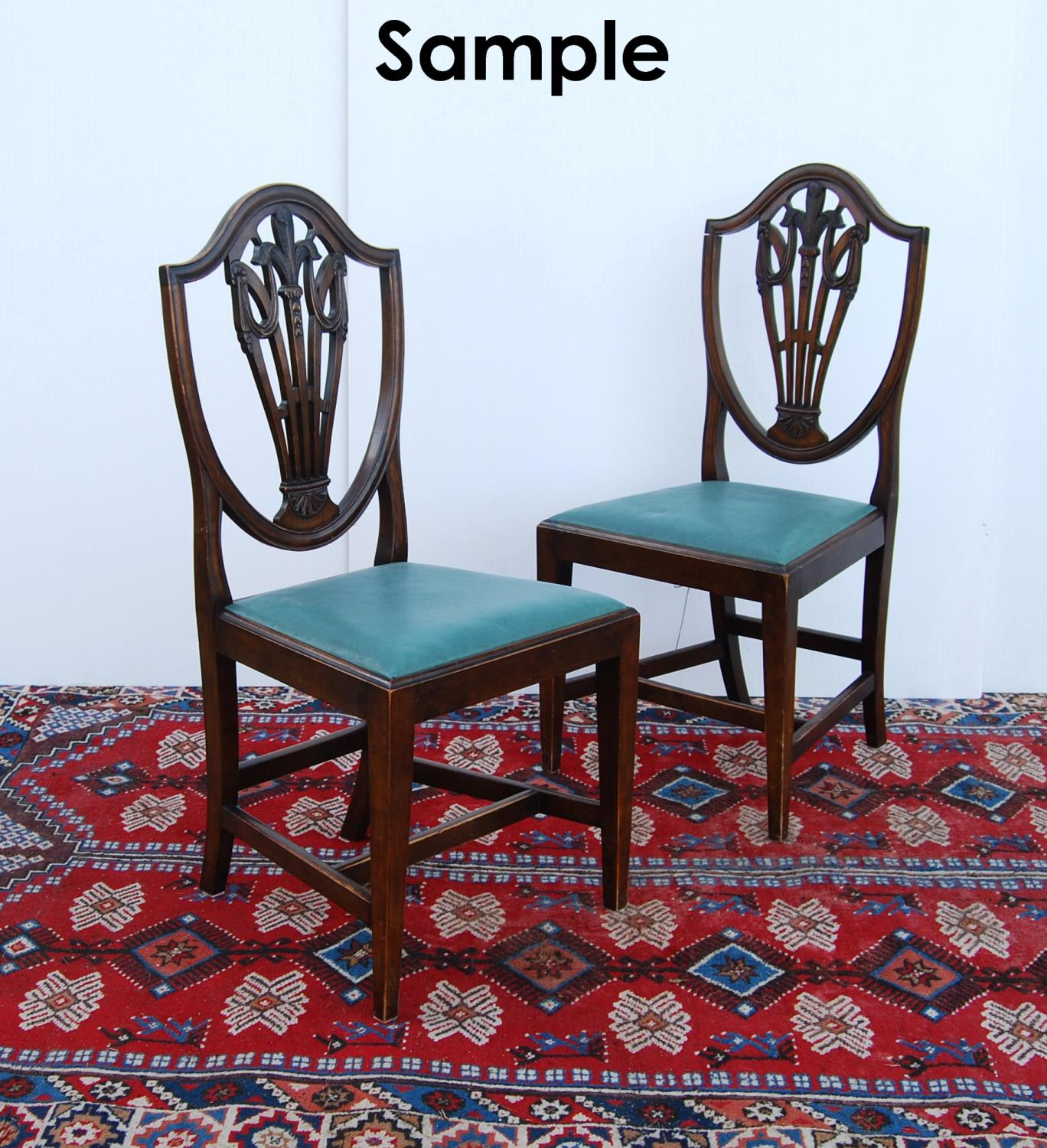 Set of mahogany dining chairs of George III design, each with moulded shield-shaped back, with