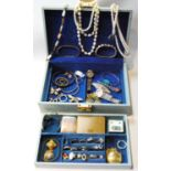 Various paste rings and other items in a jewel case.