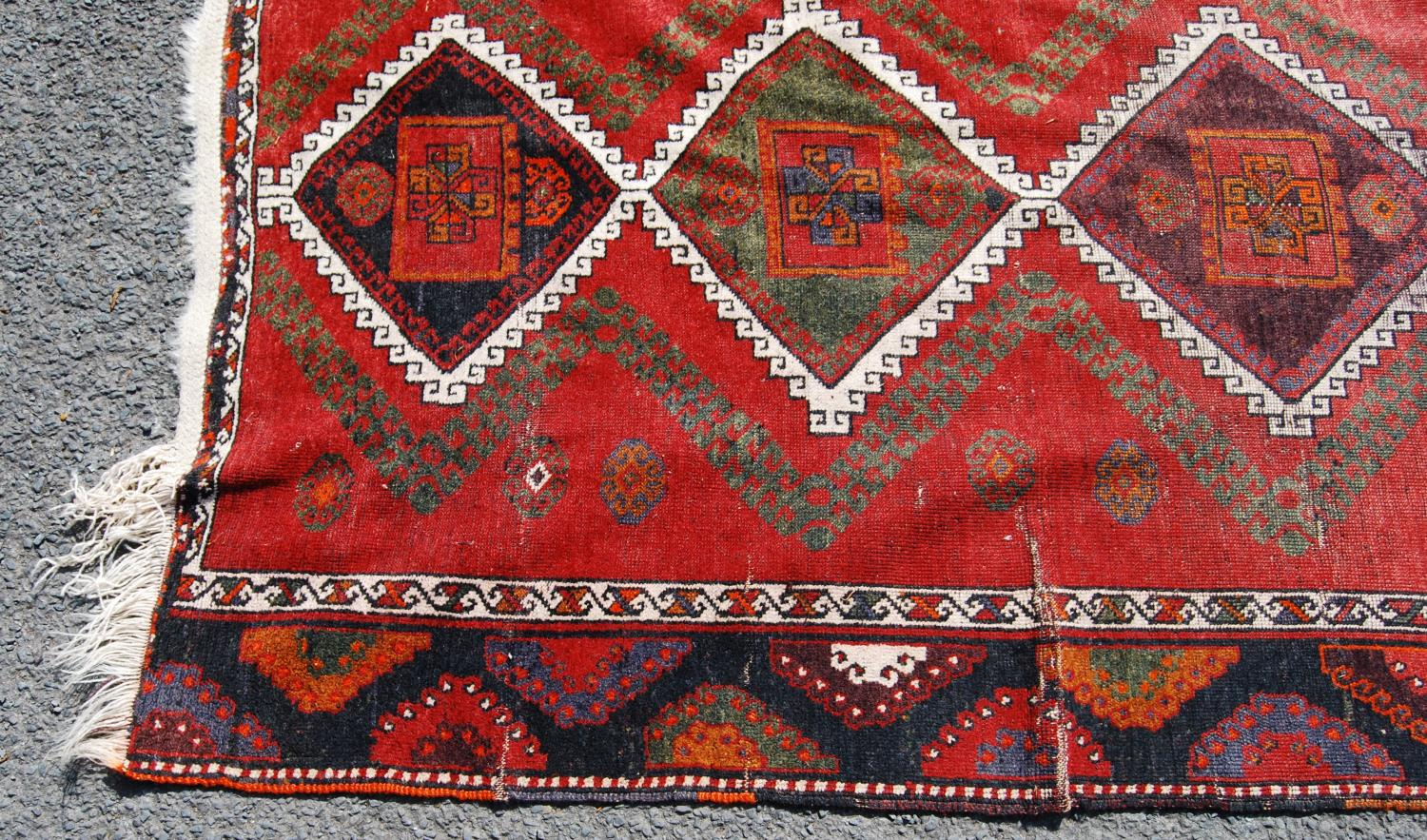 Persian long rug, the six diamonds with panel and rosettes over red ground and border, 330cm x - Image 2 of 4