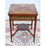 Edwardian rosewood and inlaid games table, the square envelope top over frieze drawer, on boxwood