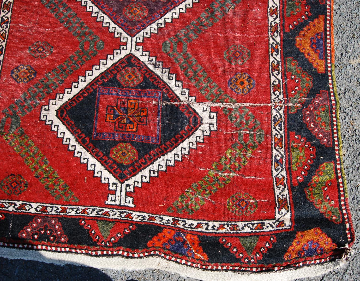 Persian long rug, the six diamonds with panel and rosettes over red ground and border, 330cm x - Image 4 of 4
