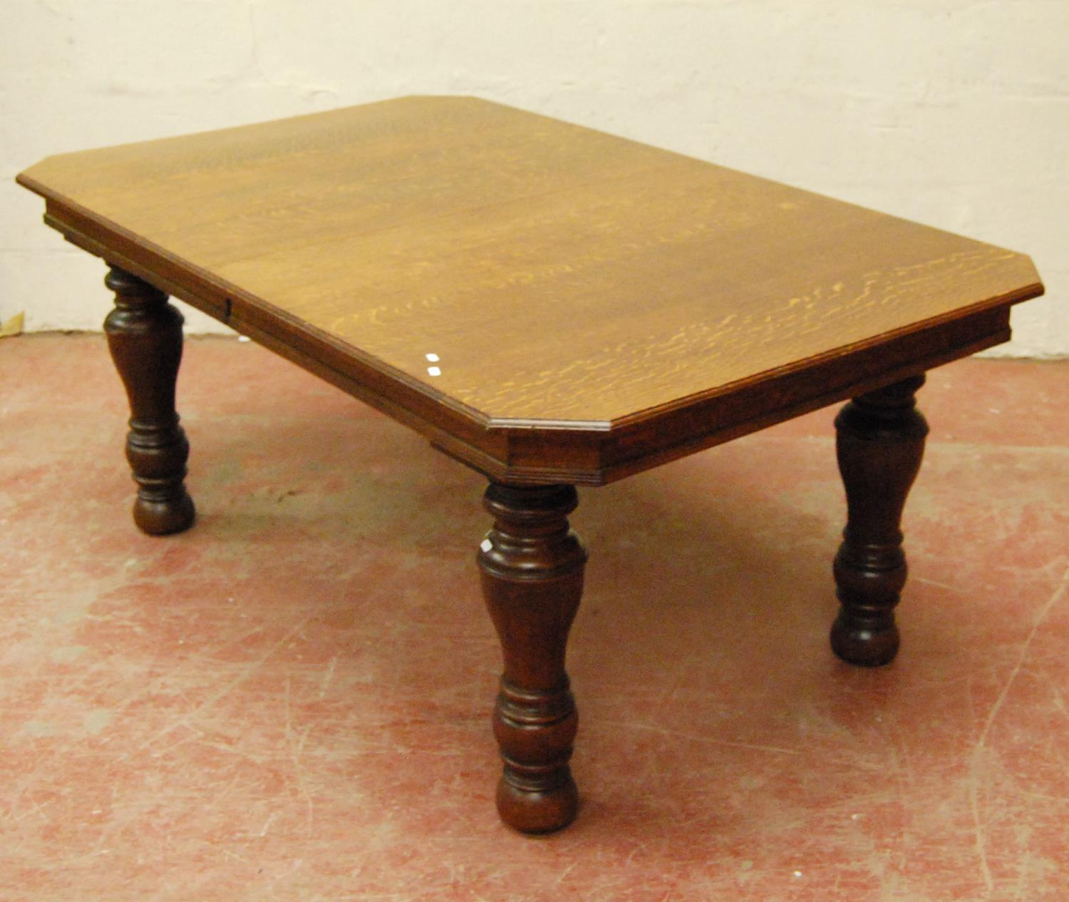 Late Victorian oak extending dining table, the moulded rectangular top with canted corners, on - Image 2 of 4