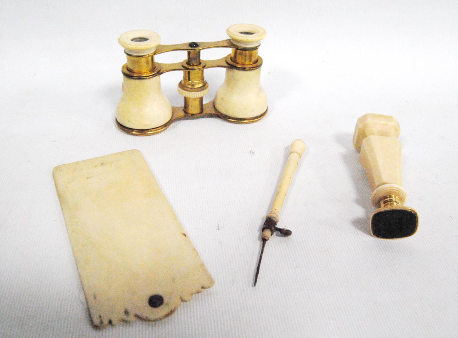 19th/early 20th century ivory scribe and plate seal, also a pair of opera glasses.