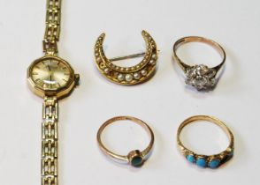 H Samuel 9ct gold bracelet watch, three rings and a crescent brooch.