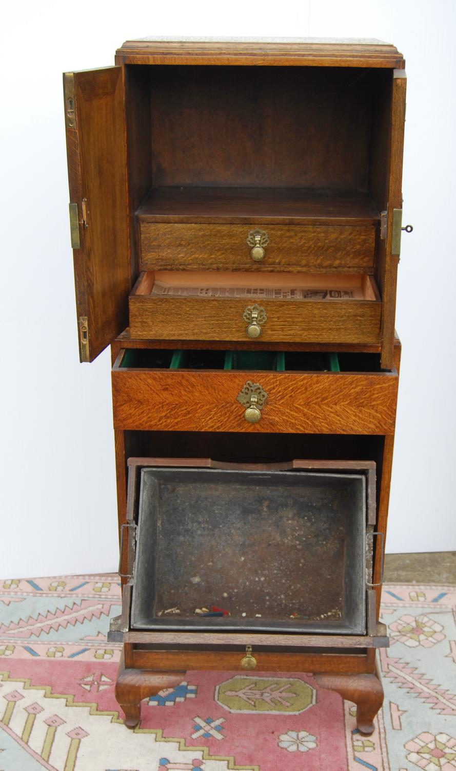 Edwardian oak cabinet on stand, the rectangular top above a cupboard with elaborate hinges and - Image 2 of 4