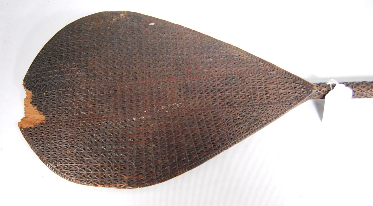 South Sea Island paddle with all over geometric carving and floral handle, 97cm long. - Image 2 of 5