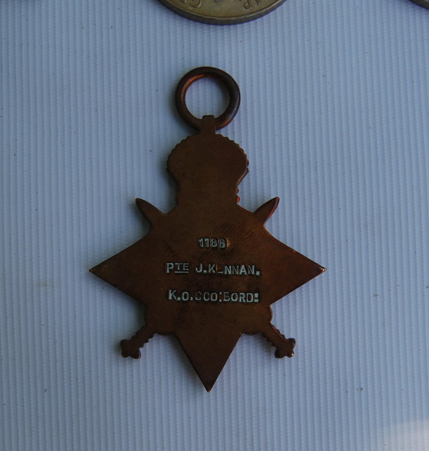 World War I medal group for Private D Kennan, Royal Scots, 3189854, Territorial Efficient Service - Image 2 of 3