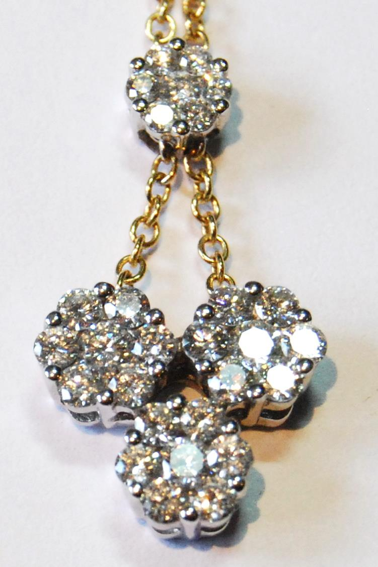 Diamond pendant with three clusters of seven brilliants dependent from another, smaller, in yellow - Image 2 of 5
