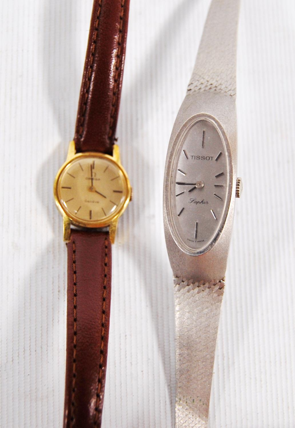 Lady's 14k white gold Tissot Saphir cocktail wristwatch, together with an Omega Genève