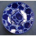 Large blue and white charger decorated with simplistic blossom and fretwork, 47cm diameter.