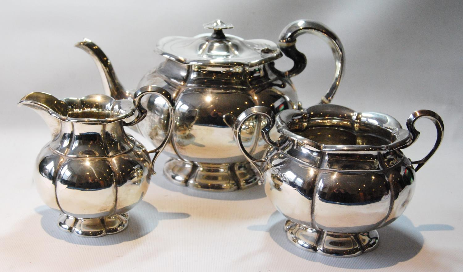 Good silver three-piece tea set of hexafoil fluted melon pattern by Sorley, Glasgow 1923, 49oz.