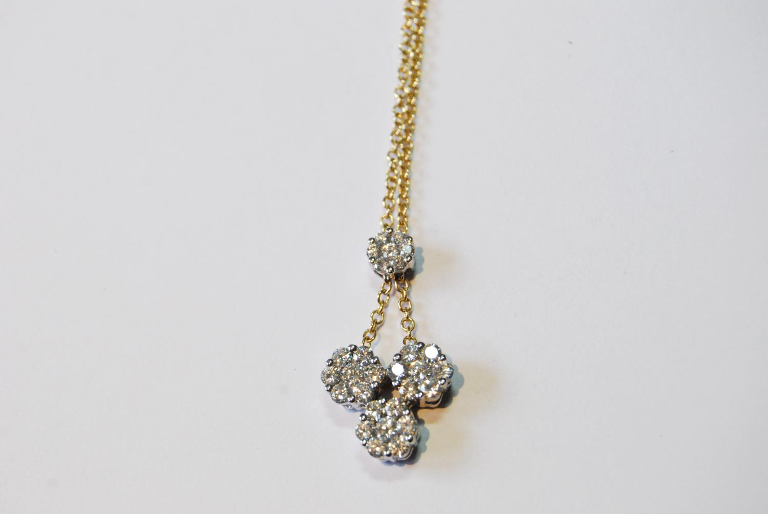 Diamond pendant with three clusters of seven brilliants dependent from another, smaller, in yellow - Image 4 of 5