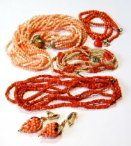 Two coral necklets, another with pearls and other similar items.