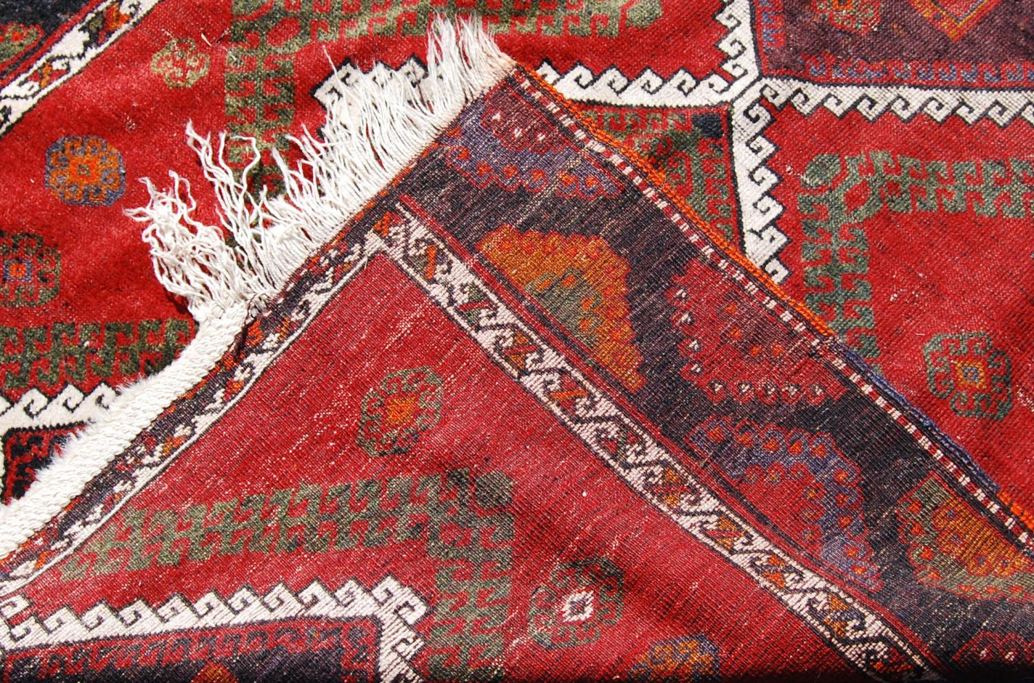 Persian long rug, the six diamonds with panel and rosettes over red ground and border, 330cm x - Image 3 of 4