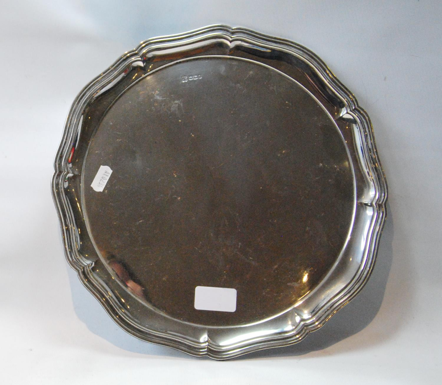 Silver circular tray with octofoil waved fluted edge, on pointed feet, Sheffield 1923, 24oz.