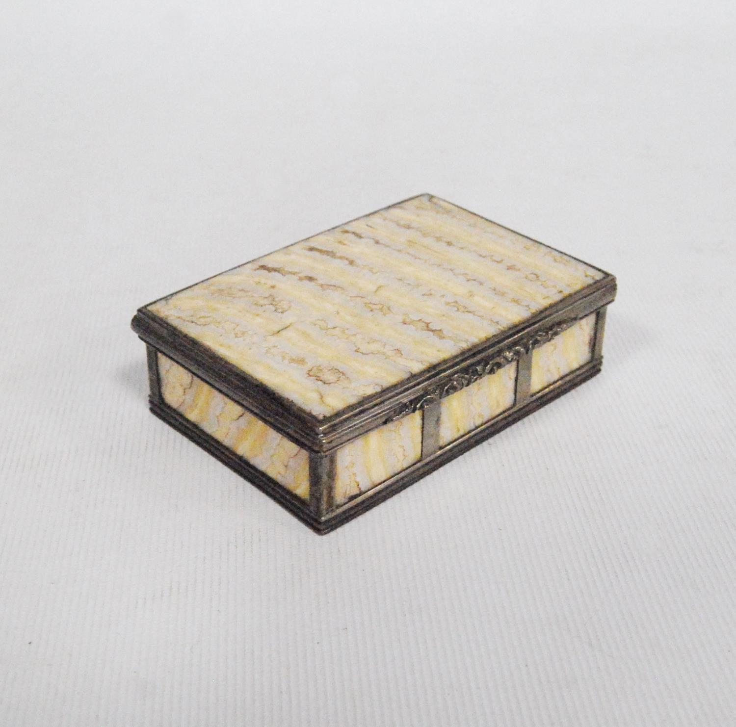 Elephant's tooth box with white metal banding and floral clasp, 7.5cm wide, 2cm high and 5.5cm deep.