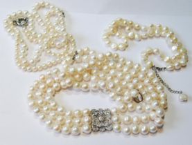 Cultured pearl three-strand necklace with paste-set square cluster, a baroque pearl single-strand