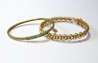 Indian gold bangle with pearls and another with diamonds and emeralds, gross 20g. (2)