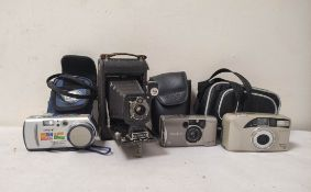 Camera lot to include three digital cameras including a Minolta Vetis 20, Sony Cybershot and an