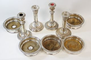 Pair of old Sheffield sliding candlesticks, another pair similar, a pair of decanter stands by